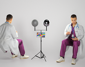 Medical doctor male is sitting and texting a 3D model 1