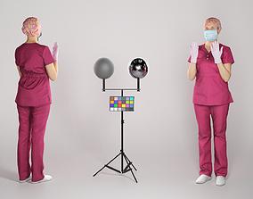 Surgeon woman in uniform and gloves preparing 3D asset 2