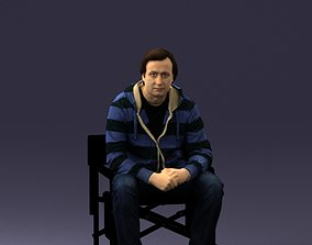Thoughtful man on folding chair 0182 3D