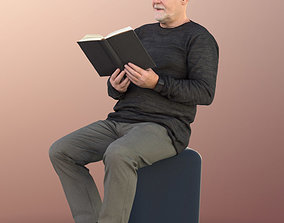 11249 Phil Old Man reading book sitting 3D asset
